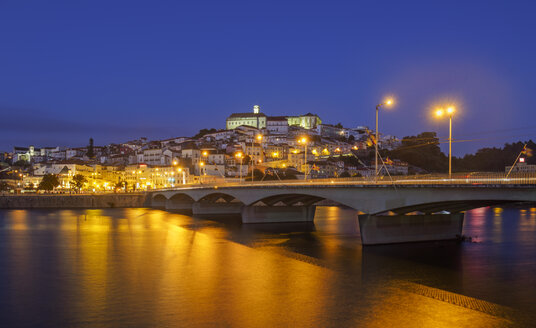 Portugal, Coimbra, historical old town, Mondego river and bridge Santa Clara in the evening - LAF001565
