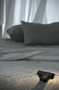 Pistol an bed - AS005755