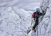 UK, Scotland, Glencoe, West Face Aonach Mor, woman ice climbing - ALRF000163