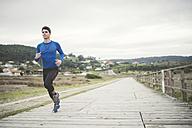 Spain, Ferrol, jogger running on a boardwalk - RAEF000670