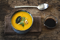 Bowl of vegan creamed pumpkin soup with walnuts and soy sauce - EVGF002527
