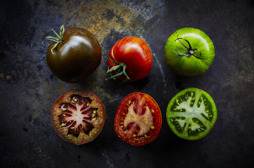 Black, red and green tomato and three halves - KSWF001667