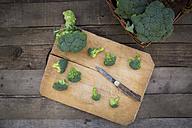 Broccoli on chopping board, knife - LVF004166