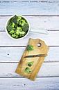Broccoli on chopping board, knife - LVF004169