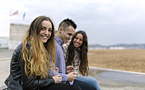 Portrait of teenage girl and her friends in the background - MGOF001075