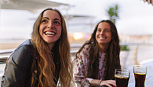 Portrait of smiling teenage girl and her female friend in the background - MGOF001078