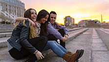 Three friends having fun together at sunset - MGOF001084