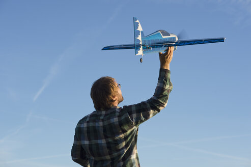 Man with model airplane - CRF002729