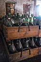 Germany, Burghausen, old wooden beer crates with empty beer bottles at Raitenhaslach Abbey - HAMF000100