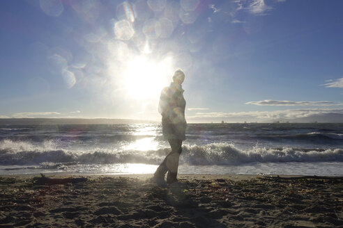 Canada, Vancouver Island, Longbeach, Person taking a walk at the beach - TMF000052