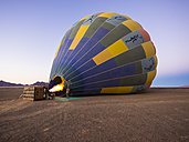 Namibia, Kuala Wilderness Reserve, Air balloon being filled with heated air - AM004448