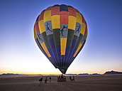 Namibia, Kuala Wilderness Reserve, People at air balloon at sunrise - AM004451
