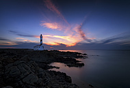 Spain, Balearic Islands, Menorca, Faro de Favaritx, Lighthouse at sunset - SMAF000396
