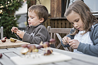 Two children tinkering with chestnuts - PAF001489
