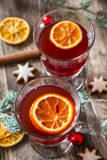 Two glasses of mulled wine with orange slices at Christmas time - SARF002333