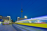 Germany, Berlin, view to television tower with driving tramway in the foreground - RJ000543
