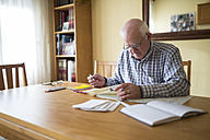 Senior man with road map planning a trip - RAEF000683
