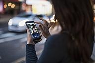 Woman taking a selfie by the roadside - MAUF000093