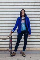 Portrait of young woman with skateboard - ZEDF000021