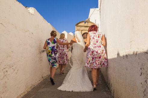 Greece, Rhodes, Lindos, bride with wedding party - WD003445