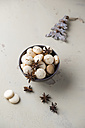 Bowl of anise cookies and star anise - MYF001252