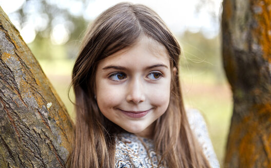 Portrait of smiling girl in nature - MGOF001116