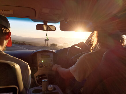 two male caucasian driving in a car, sunset, South Africa - BMA000070