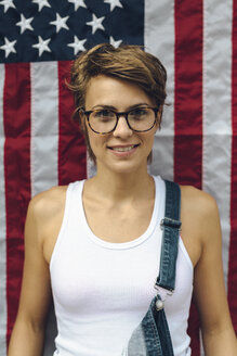 Portrait of blond woman in front of American Flag - GIOF000551