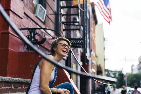 USA, New York City, Williamsburg, portrait of happy blond woman - GIOF000572