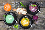 Pea soup, beetroot and pumpkin soup in bowls - SARF002376