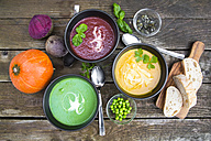 Pea soup, beetroot and pumpkin soup in bowls - SARF002379