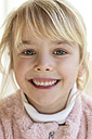 Portrait of smiling blond girl - JFEF000764
