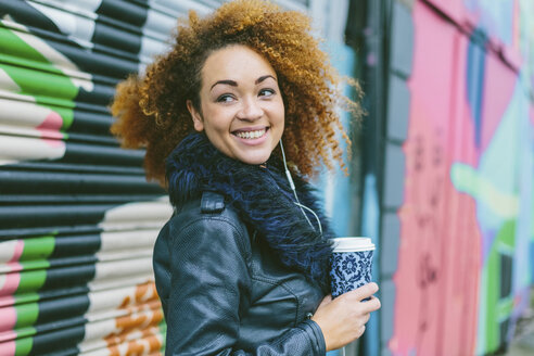 Portrait of smiling woman with coffee to go - BOYF000040