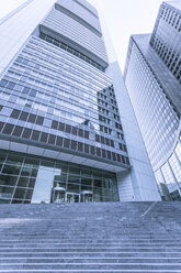 Germany, Frankfurt, stairs to entrance of an office towers seen from below - ZMF000441