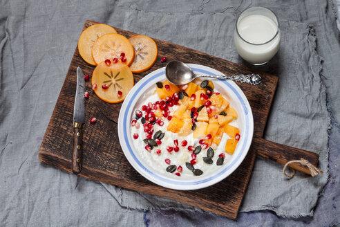 Dish of natural yoghurt, kaki, pomegranate seed, almond and pumpkin seed - SBDF002503