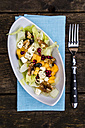 Autumnal salad with kaki, feta cheese, iceberg lettuce, pumpkin seeds, pomegranate and walnuts - SARF002388