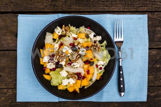 Autumnal salad with kaki, feta cheese, iceberg lettuce, pumpkin seeds, pomegranate and walnuts - SARF002391