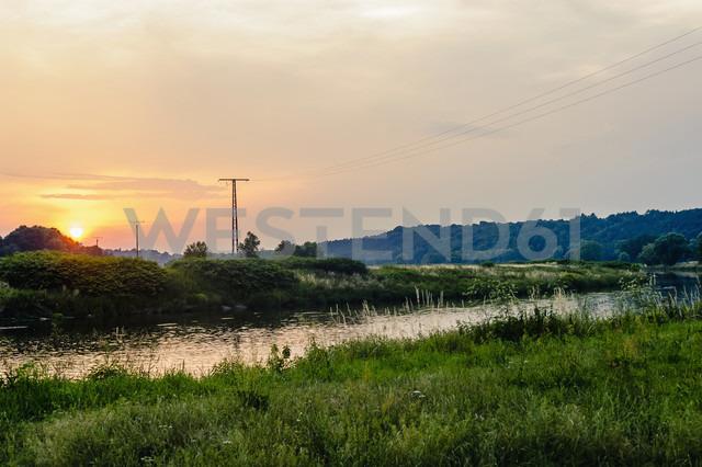 Germany, Saxony, river Mulde and power pylons at sunset - MJF001697 - Jana Mänz/Westend61