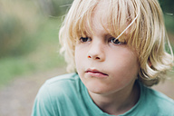 Portrait of serious blond boy outdoors - MJF001703