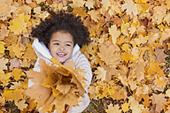 Little girl playing in autumn park - HAPF000011