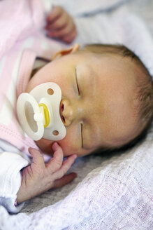 Portrait of sleeping baby girl with pacifier - HOHF001383