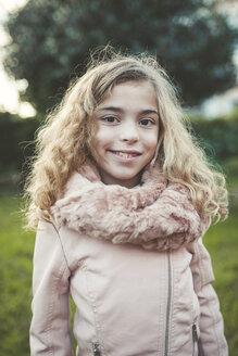 Portrait of smiling blond girl - RAEF000707