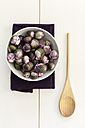 Red brussels sprouts in bowl, wooden spoon - EVGF002539