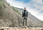Bulgaria, Rhodope Mountains, young man standing on logs - DEGF000600