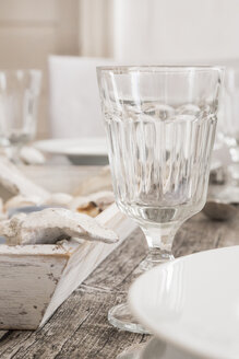 Empty wine glass on maritime laid table - LVF004302