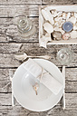 Place setting with water carafe on maritime laid table - LVF004305