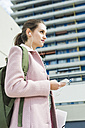 Young woman with earbuds and cell phone - UUF006171