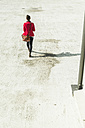 Young woman walking on parking level - UUF006204