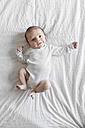 Newborn baby boy lying on white blanket - LITF000150