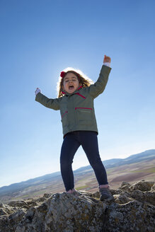 Spain, Consuegra, happy little girl on a mountain - ERLF000093